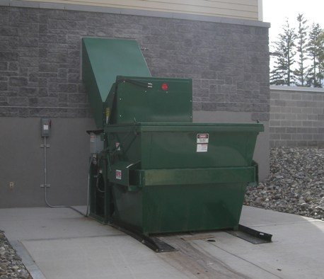 Container friendly thru the wall compactors Garbage compactor